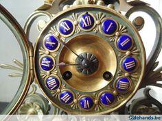 Bronzen sierlijk schouwgarnituur klok  volledig intact