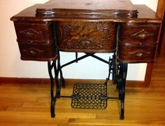 ANTIQUE FLORENCE ROTARY TREADLE SEWING MACHINE, TIGER OAK CABINET W/MANUAL ACCES