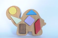 My own idea, design, and implementation - Wooden Toy Shape board by EandMToys on Etsy, $25.00