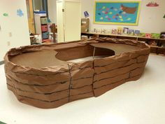 Noah's Ark for Bible class! Simply taped brown bulletin board paper around two semi circle tables and painted!