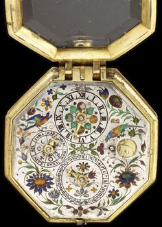 Watch:  (Case) Gilded And Engraved Brass  (Dial) Silver With Champleve And Basse Taille Enamel, Dials For The Date, The Days Of The Week And The Hours, Large And Small Apertures Show The Age And Phase Of The Moon - Made By Johannes Buz, Movement - Augsburg, Germany   c.1600
