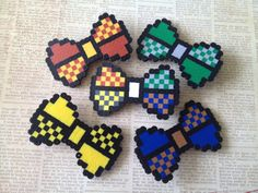 "A ""Commit to 8-Bit"" Hair Bow - Houses of Hogwarts"