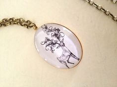 Black and White Oval Deer with Flowering Antlers Pendant Necklace | Katrinaalexa - Jewelry on ArtFire