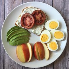 two hard boiled eggs, whole grain toast with dairy free chive cream cheese and ripe tomato, half an avocado and apple slices // pinterest @softcoffee