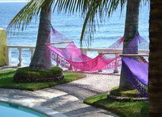El Salvador oceanfront pool and hammocks overlooking the surf.