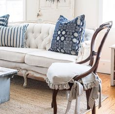 too fancy, but nice white colored couch with blue and white pillows