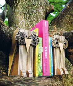 Awesome owl bookends....made out of cardboard!  and lots of other cardboard animals - from bookshelves to lamps or just statues