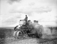 This ca. 1910 photograph shows George Hilderbrand operating a Hart Parr tractor and plow at his wheat farm near Wasco, in Sherman County. Hilderbrand, who moved to Sherman County in 1887, owned at least a thousand acres of farmland and also worked as a clerk for the local school district. He may have owned one of the first gasoline-powered tractors in the county. The image was taken by William Raymond, a Moro-based photographer who worked between 1899 and 1935.