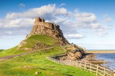 Lindisfarne Castle, Northumberland, Great Britain....Been there!  I waded in the North Sea.  If the tide comes in while you are on the island, you are stranded until the next low tide.