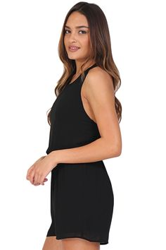 Black chiffon racerback romper featuring a drawstring waist and zipper closure down the back. This romper is the perfect year-long addition to your wardrobe. Dress it up or down for any event!