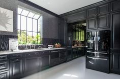 This year's House Beautiful Kitchen of the Year designed by Steven Miller Design Studio with a stunning contrast of black cabinetry and white Caesarstone countertops.