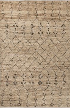 Known for environments that are sleek and serene with a touch of glamour, designer Nikki Chu takes on the desert for an all-natural rug crafted in a blend of jute and wool that appears faded by time and unrelenting sun.Pantone Colors Include: Taos...