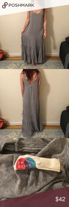 Free People Beach Grey Jersey Maxi Ruffle Dress Free people Beach with a tiered ruffle bottom and is sleeveless - soft fabric and is in good condition! Size small! Free People Dresses Maxi
