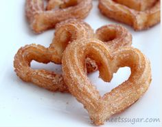 I love Churros! Churros Dough 1 cup water 2 tablespoons white sugar teaspoon salt 2 tablespoons vegetable oil 1 cup all-purpose flour 2 quarts oil for frying Cinnamon Sugar cup white sugar, or to taste 1 teaspoon ground cinnamon Valentine Desserts, Köstliche Desserts, Delicious Desserts, Dessert Recipes, Yummy Food, Valentine Treats, Homemade Valentines, Saint Valentine, Mexican Food Recipes