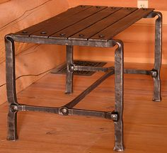 blacksmith. hand forged bench. Morris L