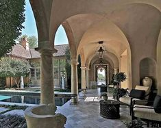 neutral mediterranean loggia with arched entryways luxe seating areas pinterest. Black Bedroom Furniture Sets. Home Design Ideas