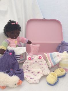 My friend was looking for a black doll for her little granddaughter and all she could find was a golly. When she saw the Pocket Poppets I had designed she asked if I would knit her a black one for her granddaughter. Of course I would!  She's packed her case, said goodbye to her friends and now boxed up waiting for me to take her to the post office.