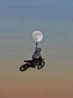 Bike Rider touching the moon. Of course sometimes the optical illusions are really funny. Even this one.