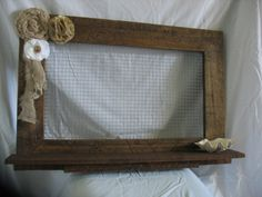 Jewelry Frame made from recycled pallets, handmade fabric flowers, & attached seashell for rings & studs. Done & done.