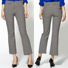 "| Trina Turk | Fez Houndstooth Crop Pant A pixelated houndstooth pattern and abbreviated hems usher a classic style into contemporary vogue. A front-notched waistline and streamlined, hidden side zip further update the figure-flattering look. Front slant pockets. Approx. inseam: 27 1/2"". Approx. rise: front 9""; back 15"". Partially lined. Cotton; dry clean. By Trina Turk; made in the USA. Individualist. Trina Turk Pants Trousers"