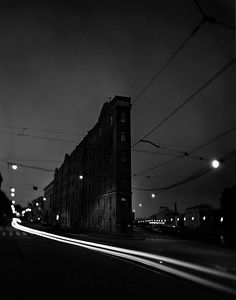Time lapse at night past a flatiron building, unk.
