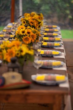 Rustic sperry tent wedding rehearsal dinner with a Tennessee BBQ vibe. Wooden long tables dressed with sunflower centerpieces custom speckled metal plates napkin wrap menus and custom BBQ bibs! Planned by Jubilee Events. Fall Rehearsal Dinners, Rehearsal Dinner Decorations, Bbq Party, Drink Bar, Barbeque Wedding, Sunflower Centerpieces, I Do Bbq, Tent Wedding, Fall Wedding