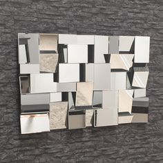 This crazy but stunning large multi faceted mirror is something no modern home should be without. The light bounces of the multiple pieces of glass that have been used to create this stunning mirror and instantly brighten up your home. For customers after the wow factor look no further than