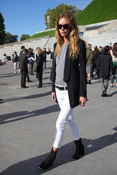 Black blazer, wedge boots, belt; white skinny jeans; grey t-shirt