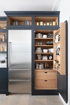Here, a smart navy grey pull-out larder-style cabinet helps to provide extra storage space in a small kitchen. The shelves above are excellent for pla. Home Decor Kitchen, Interior Design Kitchen, Home Kitchens, Home Design, Interior Decorating, Decorating Ideas, Kitchen Larder, Kitchen Pantry Cabinets, Pantry Cupboard