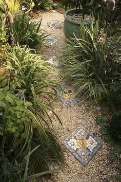 Jenni Woodruff's exquisite garden | GardenDrum Mosaic stepping stones echo the garden's theme colours