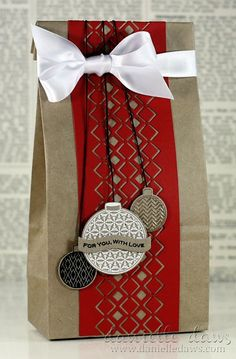 Decorate that brown paper bag with a scrapbook border, some stamped ornaments, ribbon and string.  Merry and Bright!