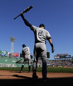 New York Yankees designated hitter Derek Jeter loosens up in the on-deck circle as he prepares to face Boston Red Sox starting pitcher Joe Kelly in the first inning of a baseball game at Fenway Park in Boston, Saturday, Sept. 27, 2014. At left is lead off hitter Ichiro Suzuki.