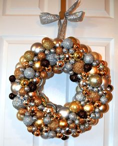 - This ornament wreath holds over 100 ornaments ranging in sizes, colors and finishes - Gold, Silver, Bronze and Blush colored ornaments glued to a styrofoam ring hangs lovely on wreath hangers and lo