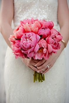 All coral/pink bouquet, add broach to ribbon around the stems