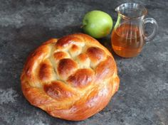 Apple Honey Challah - This fluffy apple-stuffed homemade challah is braided round for Rosh Hashanah. Sweet, fragrant and delicious holiday recipe. | ToriAvey.com #challah #applesandhoney #roshhashanah #jewishholidays #chagsameach #apples #honey #bakingproject #braidedbread #braiding #shabbat #highholidays #shabbatshalom Challah Bread Recipe Honey, Honey Roasted Carrots, Rosemary Simple Syrup, Honey Glazed Chicken, Slow Cooker Brisket, Braided Bread, Beet Salad Recipes, Honey Recipes, Loaf Recipes
