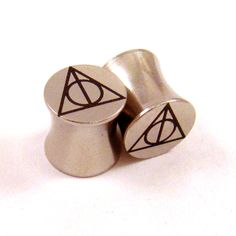"Sign of the Deathly Hallows Steel Plugs - Double Flared - 2g 0g 00g 7/16"" (11 mm) 1/2"" (13mm) 9/16"" (14mm) 5/8"" (16mm) Metal Ear Gauges. $19.75, via Etsy."