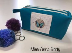 Trousse Zip-Zip bleue et coupon papillon cousue par Atelier de couture Miss Anna Berty - Patron Sacôtin