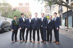 groomsmen - dark suits with brown shoes