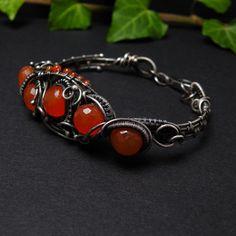 Bold bracelet , wirework jewelry , wire wrapped silver oxidised , orange carnelian gemstone. $300.00, via Etsy.