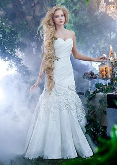 A woman wearing the Rapunzel wedding gown from the Alfred Angelo Bridal Collection Disney Inspired Wedding Dresses, Rapunzel Wedding Dress, Tangled Wedding, Princess Wedding Dresses, Wedding Dress Styles, Disney Weddings, Rapunzel Hair, Disney Rapunzel, Princess Rapunzel
