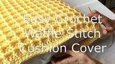 Free pattern and video for this crochet cushion cover using the easy to learn crochet waffle stitch. This crochet pillow cover makes a perfect crochet gift! #crochetcushioncover #crochetpillowcover #crochetwafflestitch #freecrochetpatterns #crochetfreepatterns #crochethomedecor #crochetgiftideas #crochetteachergift #crochethousewarming
