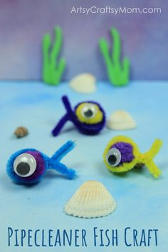 Simple Pipe Cleaner Fishing Game -  Use Pompoms & pipe cleaner ( chenille sticks) to make adorable little fishes that you can catch - via Artsy Craftsy Mom    Pipe cleaner crafts for kids | Ocean Crafts | Under the Sea Party props