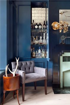 Adopt an alcove and give it a new identity by filling the shelves with an enticing mix of drinks and glassware