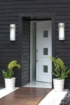 Modern white door..like the white, dark grey, warm colour wood & stainless steel together.