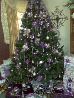 This is my purple Christmas tree. Call me crazy but the wrapping paper must match the tree. Just a little OCD maybe. LOL