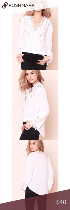 Crochet Trim Surplice Long Sleeve Top Crochet trimmed woven shirt. Long sleeves. Surplice neckline. Unlined. Material: Rayon Color: White Model is wearing a small Tops Blouses