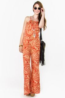 Make a statement in this paisley print jumpsuit. Features a halter neckline and open back. Looks cute with layered necklaces and gladiator sandals.    www.shopdeserthearts.com