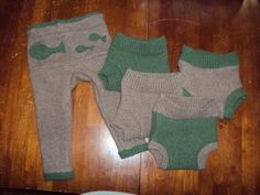 Tutorial for making your own wool shorties out of an old sweater, to use over fitted or prefold cloth diapers.