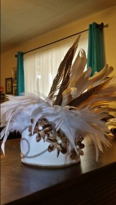 Tahitian headpiece in tapa handmade flowers with pearl centers, feathers and jute