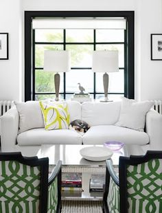 White sitting area. I love the black window trim and the green fabric for the accent colors in the space.
